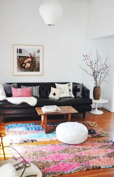 Black leather couch with pops of pink