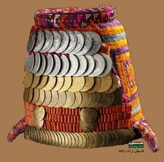 The traditional Bethlehem headdress, with the 'Shatweh' hat, whose front is covered with rows of coins, beads and coral was worn by married women of three neighboring villages, Bethlehem, Beit Jala and Beit Sahur.