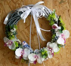 Wicker wreath with a white orchid accent and little by Skygriffin