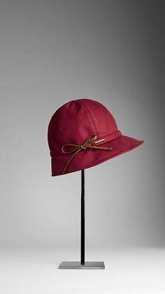 Burberry Bow Detail Cotton Gabardine Rain Hat. looks sorta cloche and part rain hat-cute!
