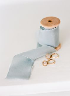 #gold, #earrings, #something-blue, #ribbon  Photography: Rebecca Yale Photography - rebeccayalephotography.com Rings: Longs Jewelers - www.longsjewelers.com/