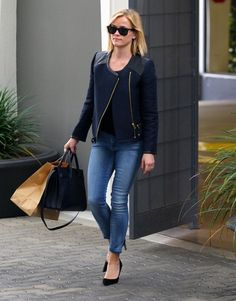 An updated moto jacket adds some edge to a classic jeans & tee pairing. (Reese Witherspoon)