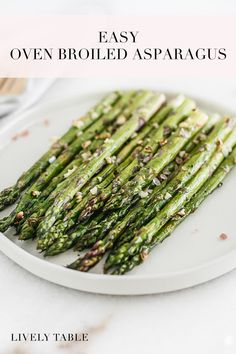 If you're looking for a healthy, quick, and easy weeknight veggie, this oven broiled asparagus with garlic is it! Just a few simple ingredients and 10 minutes is all it takes for delicious and asparagus that are perfectly cooked. (gluten-free, vegan) Grilled Asparagus Recipes, Oven Roasted Asparagus, How To Cook Asparagus, Yummy Vegetable Recipes, Whole Food Recipes, Vegetarian Recipes, Healthy Recipes, Vegan Side Dishes, Best Side Dishes
