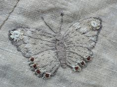 'Gentlework' moth made by hand, a hand craft that incorporates vintage fabric and finds, and involves sewing and embroidery.