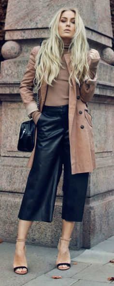 Angelica Blick wears leather culottes with a nude polo jumper and matching trench coat. Polo: Gina Tricot, Trousers/Shoes: River Island, Jacket: ASOS.