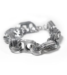 Bracelet made from recycled pop tops and aluminum jump rings via Escama Studio.