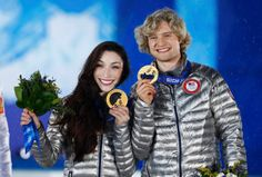 Gold medalists Meryl Davis and Charlie White of the U.S. celebrate during the medal ceremony for the figure skating ice dance free dance program at the 2014 Sochi Winter Olympics Feb. 18, 2014.