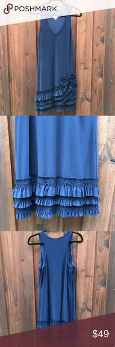 "Oleg Cassini ruffle hem v-neck dress navy size 10 Never worn Oleg Cassini navy lined blue dress. Flattering heavy drape that helps hide body flaws. Tastefully ruffled at the bottom gathered up with flowers. The fabric is luxurious and feels as classy as it looks.  length: 37"" armpit to armpit: 19"" Oleg Cassini Dresses"