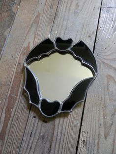 Black stained glass bat mirror