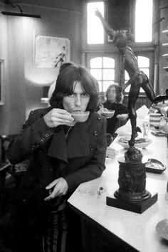 Don McCullin/photographer/ 1968/George Harrison A Day in the Life of the Beatles./ George Harrison and you can see John Lennon at the rear of the cafe.