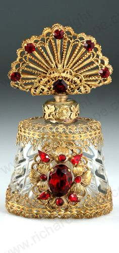 c.1930s JEWEL CAGED CLEAR GLASS SCENT BOTTLE WITH JEWELLED STOPPER, CZECHOSLOVAKIAN.  http://www.richardhoppe.co.uk