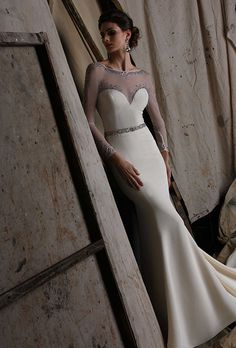 Brides: Victor Harper. Four ply crepe gown. Fit and flare with jeweled stretch illusion yoke.