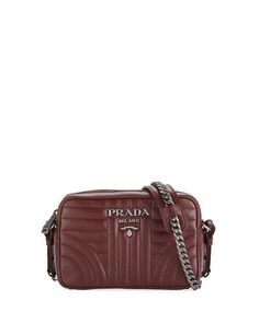 79a49d822df9 Get free shipping on Prada Diagramme Camera Bag at Neiman Marcus. Shop the  latest luxury