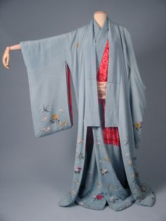 "1870's Kimono and Dounuki (kimono under-layer worn between kimono and juban; this antique layer often matched the top layer kimono and was produced with it.)  This ensemble would have been worn with an obi, and is displayed open so that you can see the matching dounuki- which, as is often the style, has the ""hidden"" areas done in a seductive bright red.  This was a part of the ""iki"" style- hidden extravagance beneath a shabby/drab visible exterior."