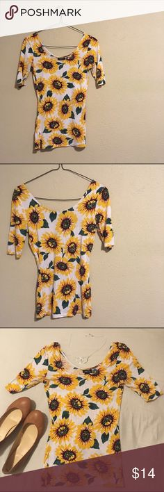 """Sunflower Print Tee Cute and dainty sunflower short sleeve t-shirt//form fitting//scoop neck//three-quarter length sleeves//has some stretch//very light wash wear  95% rayon 5% spandex  Measurements: armpit to armpit length @ 14"""" total length @ 22.5"""" Rue21 Tops Tees - Short Sleeve"""