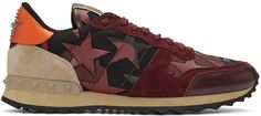 Low-top canvas sneakers featuring camouflage pattern in black and burgundy. Suede trim in burgundy throughout. Leather star appliqués throughout. Round toe. Lace-up closure in burgundy. Logo flag at padded tongue. Leather heel tab in orange featuring hemisphere stud and stone detailing. Suede panel and signature rubberized pyramid stud detailing in beige at heel counter. Mesh lining in black. Foam rubber midsole in tan. Treaded rubber sole in black. Tonal stitching.