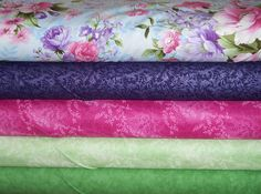 Silhouette's (large floral), Blackberry Fairy Frost, magenta & Mint vines and green mottled fabric here at Robin's Nest: Quilts & More.  www.robinsnestquilts.com