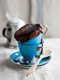 Brownie in a cup with chocolate frosting with powdered sugar!! But they make it looks fancy!