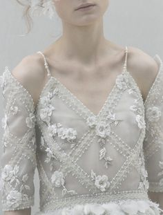 White on white fashion - delicate detailing with beaded ribbon patterns & fabric flowers; femininity & innocence // Chanel Haute Couture ss13