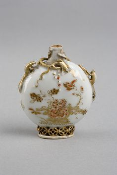 Snuff bottle | V&A Collections Porcelain, painted and gilded, with relief decoration. Qing dynasty 18th century.