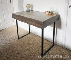Build a small computer desk with Pipe Legs and a HIDDEN DRAWER! Modern, clean lines and functionality all in one. Grab the FREE PLANS!