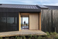 Chilmark House: redesign of old barns with low pitched roofs by Gray Organschi Architecture + Aaron Schiller - CAANdesign Massachusetts, Black House Exterior, Saint Ouen, Two Storey House, Wood Patio, Modern Barn, Martha's Vineyard, Old Barns, Prefab Homes