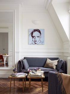 We've featured quite a few places by A+B Kasha before: this Paris-based real estate and design firm excels at creating meticulously detailed apartments where just the walls and floors themselves are a work of art. My current favorite project of theirs is a little jewel of a one-bedroom, 270 square feet of perfection tucked away on the top floor of a 19th-century building in Paris' 6th arrondissement.
