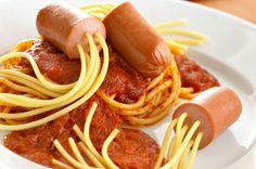 Squid Dogs. Cut hot dogs into small inch long pieces. Stick pieces of spaghetti lengthwise through each hot dog piece till it has even length on each side of the hot dog piece. Each hot dog piece should have between 5-7 pieces of spaghetti. Cook squid dogs in a large pot of boiling water according to spaghetti instructions. Once spaghetti is cooked then enjoy with your favorite sauce.