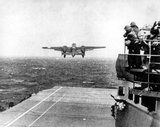 """Then-Lt. Col. James H. """"Jimmy"""" Doolittle (center) is surrounded by airmen at an advanced air base in Tunisia on Jan. 28, 1943. Below them, a B-25 Mitchell bomber takes off from the USS Hornet's flight deck for the bombing mission over Japan on April 19, 1942. (Associated Press photos/Illustration by The Washington Times)"""