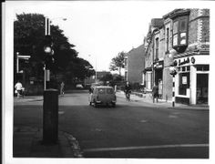 Rabey Road, Hart Lane traffic lights. Cemetary wall can be seen on the left of picture. The building over the road where demolished and housing estate built early seventies. This picture would date from sometime in the sixties I think.