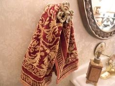 drapery tiebacks used for towel holder.