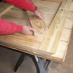 With the rails and stiles of the barn door in place, the next step of these free woodworking plans is to add a diagonal 2x6 frame member for strength.