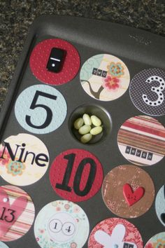 Advent Calendar out of  a mini muffin tin, magnet paper and scrapbook paper -- GREAT idea to reuse year after year
