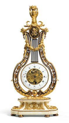 Pendule lyre en bronze doré et marbre blanc d'époque Louis XVI, le cadran signé FURET A PARIS  A GILT-BRONZE AND WHITE MARBLE LYRE MANTEL CLOCK, LOUIS XVI, THE DIAL SIGNED FURET A PARIS