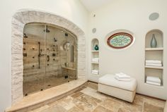 This is beyond extravagant... but what an amazing shower..spanish style home