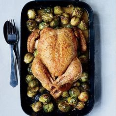 Whole Roast Chicken with 40 Brussels Sprouts | When F&W's Kay Chun roasts chicken, she adds brussels sprouts to the roasting pan so they absorb the fantastic flavor of the caraway-infused chicken juices.