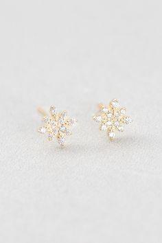 Twinkling Flake Stud Earrings (14K) $15 // Snowflake stud earrings with a hypoallergenic gold undertone.