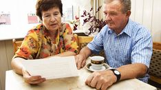 An older couple looking over their Social Security benefits.