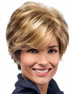 "Avery Wig by Estetica Designs. A short, wispy layered style with flared back and long side swept bangs. Features the innovative ""PURE STRETCH CAP"" construction."