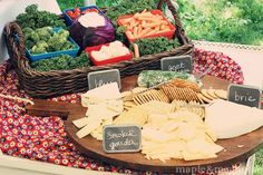 serve cheeses and veggies in a large basket