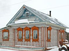 "Located in Siberia, Russia this is one of many fairytale houses carved in the early 1900's by talented craftsmen. In those days, these industrious russian ""elves"" flocked to Tomsk and other Siberian cities, and their art thrived. To create such carvings from wood was their way of honoring the Siberian forests and they competed to show off their most lavish wooden designs. Each piece of the gingerbread was painstakingly hand carved and then mounted on the building's facade."