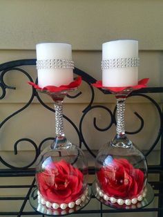 I made this elegant candle holder using wine glass upside down on top of the mirror. Its decorated with pearls and diamond wrap. There is a silk flower inside. Vanilla scented candles are included and decorated as well. This candle holder may be used for a wedding gift table, candy bar, cake table or a wedding shower table.  Size: 8.5 inches height (11.5 with candle) 4 inches width  Flowers colors may vary or customize your candle holders. Choose flowers and colors and ask me if I have it in…