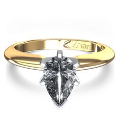 1/4 ctw Pear Shaped Diamond Ring in 14k Yellow Gold