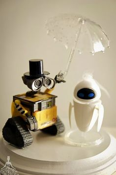 Why settle for a generic cake topper when you can create something truly personal and meaningful to you? Use action figures from toy stores and other creative sources for a one of a kind topper. Wall-E and Eve cake topper. Wall E, Creative Wedding Cakes, Wedding Cake Designs, Walle Y Eva, Our Wedding, Dream Wedding, Wedding Ideas, Wedding Rings, Amelia Wedding