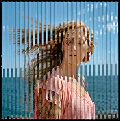 Quantum Blink by Isabel Martinez. The photograph is composed of two exposures taken instants apart. The striped  pattern is the result of masks placed in-camera, this feature allows the artist to blend two images together  and at the same time keep them from fully fusing onto one another.