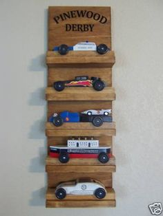 pinewood derby car display idea...if we have a boy I can combine Tyler and our sons pinewood derby cars!