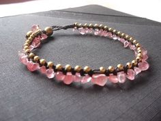 A personal favorite from my Etsy shop https://www.etsy.com/listing/106941490/gold-brass-beads-and-pink-tourmaline