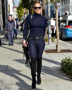 Figure-flaunting fashion: Clearly Jennifer Lopez was taking influence from her song, Booty, when she decided to showcase her famous derriere and incredible body during a relaxed Sunday stroll in Los Angeles
