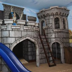 Go back in time to the days of chivalry and magic in the Medieval Castle Playhouse and Mural. This elaborate two story playhouse is meticulously detailed and has many nooks to hide and play in. Complete with tower ladder and escape slide this playroom set is amazingly fun. The coordinating mural is full of medieval knights encaged in battle with ferocious flying dragons.