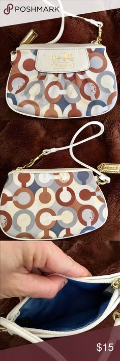 Coach poppy wristlet . Few stains. Lots of life!!! Coach poppy wristlet . Few stains. Can be cleaned !!!Lots of life!!! Coach Bags Clutches & Wristlets